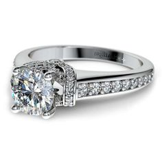 Shimmering stunner: With elegant pave-set diamonds and surprise diamond sparkle on the sides, the Ribbon Surprise Diamond Engagement Ring in Platinum exudes both vintage lustre and modern glam.. Perfect for that Forever moment! http://www.brilliance.com/engagement-rings/ribbon-surprise-diamond-ring-platinum
