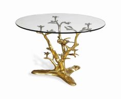 A brass and glass top coffee table, 1970s The based modelled as braches with flowers, foliage and birds #lestroisgarcons