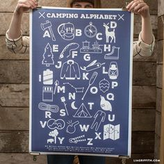 Cute navy and white camping themed alphabet poster available for purchase from handcrafted lifestyle expert Lia Griffith.