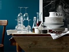 Everything you need for a delightful dinner party -- a LÖNSAM carafe, SVALKA red wine glasses, and ARV dinnerware.