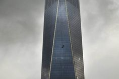 A scaffold carrying two workers hangs 69 floors up at One World Trade Center in New York City on Nov. 12, 2014.