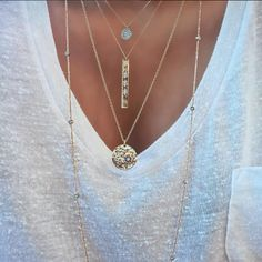 Master the art of layering delicate necklaces by pairing strands that are 1 to 2 inches apart in length. Complete the look with an extra long necklace that will hang lower than the rest (think 3 to 6 inches).