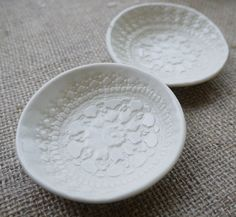 This gorgeous little ceramic ring dish set is hand formed from fine porcelain (dishwasher & microwave safe). Gently pressed with vintage lace, it is glazed with a clear, glossy foodsafe glaze. Each dish measures about 7-8cm in diameter. Your dishes will come neatly packed in a gift box. Lovingly handmade in the Blue Mountains! Check out www.mrspetersonpottery.com for Porcelain Care Instructions