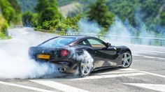 FERRARI F12 Berlinetta doing donuts http://www.autoevolution.com/testdrive/ferrari-f12-berlinetta-review-2013.html