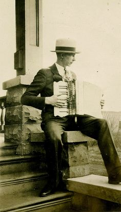 Accordion Player on the Porch by WonderfullyStrange, via Flickr
