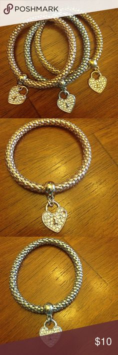 Heart On Fire bracelets NEW - You get all 3 stretch bracelets. One each in silver tone, gold tone and Rosegold tone.  Will fit most. Rhinestone heart pendants dangle. Wear one or wear them all at once. Jewelry Bracelets