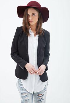 White blouse, distressed pale denim, black boyfriend blazer, and ox blood hat.