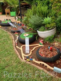 """Create play area along back of house next to deck. ITEM: Fine Motor (trains), Dramatic Play (small world play in planters) Recycle City at Puzzles Family Day Care ("""",) Outdoor Learning Spaces, Kids Outdoor Play, Outdoor Play Areas, Backyard For Kids, Indoor Play, Childrens Play Area Garden, Kids Outdoor Spaces, Backyard Play Spaces, Natural Playground"""