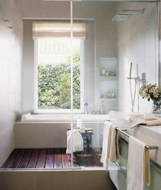 LOVE the shower floor. Definitely doing this when we remodel our bathroom.