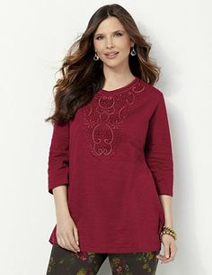 Arabesque Tunic: Exotic and artistic, this feminine tunic features a delicate, crochet floral applique down the neckline for a stand-out look. Metallic lurex yarn shines along the crochetwork to give you a soft glow. Comes in a cozy, slub knit fabric for all-day comfort. catherines.com #Catherines #plussize #plussizetop