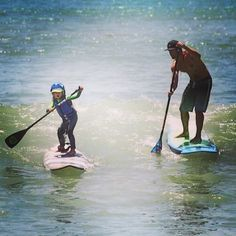 """Teach 'em young"" with Brennan Rose & grom. PC: Riviera Paddlesurf."