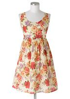 Sleeveless dress with back tie and zipper for better fit.