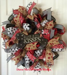 This burlap and paper mesh wreath is perfect for any dog lovers home.  Made with a burlap base and black, white and red paper mesh ruffles