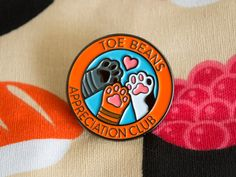 Toe Beans Appreciation Club Enamel Pin . Comes with a black rubber clutch on the back.  In stock now! Packed in a bubble envelope.  Pin size: 30mm x 30 mm