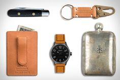 EDC: Sneerwell War Eagle Noble Flask ($65). Tsovet SVT-RS40 Watch ($325). Shinola Money Clip Card Wallet ($150). Apolis Transit Issue Key Chain ($38). Antique German Pocket Knife ($80).