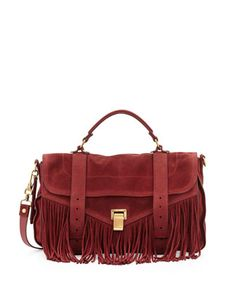 WINE ANYONE? - wine colored suede and fringe makes for the perfect accessory. Proenza Schouler, 212 872 2615