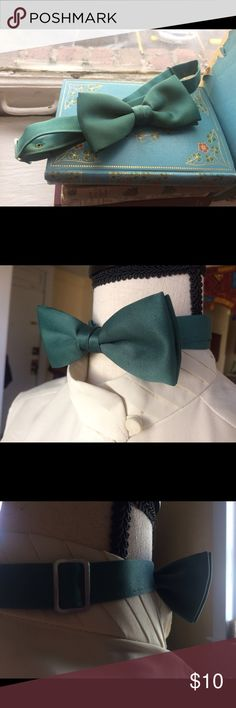 Vintage Sage Bowtie Vintage bow tie sourced from a market in Amsterdam. Original adjustable metal sliders. Some hand stitching on back of bow. Accessories Ties