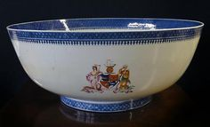 """A Rare Chinese Export Armorial Porcelain Punchbowl    Qianlong, CIRCA 1790    Diameter: 15 1/2""""    Inventory Number 8391-37  Price    38,000  Description    Bearing the coat of arms of The Canadian Trading Company with the motto """"Commerio, liberali, Crescimus"""" and incorporating a native American Indian and the figure of Britannia, surrounded by a beaver, mink, seal and whale set below a sailing vessel. Qianlong, CIRCA 1790."""
