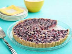Blueberry-Lemon Tart : Tyler combines two of spring's most-vibrant flavors with this eye-pleasing tart. Simply add blueberries to your prepared tart shell before pouring on a zesty homemade lemon custard. via Food Network