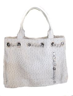 """Item #: PU-0005 - The """"Nicole"""" concealed carry bag is a beautiful and iconic design with stunning chain accents featuring an exterior locking concealed pocket with hanging charm chain for easy access."""