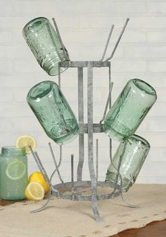 """This tall rack is inspired by a wine bottle rack. Measures 11"""" wide at base and 19"""" tall. Holds our juice glasses, or any small glass about 4"""" tall. Decorate this unique rack with Christmas lights, or"""