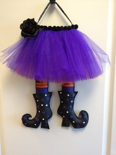 I could SO make that!  Witches Legs Burlap Door Hanger by ILoveItDesigns on Etsy, $30.00