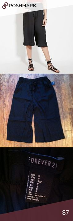 NWT Forever 21 culottes pants Small •New with tag •Tie and elastic waist •Color: Black •Satin •Wide leg style •Pockets on each side •Brand: Forever 21 •Size: Small •NO TRADES Forever 21 Pants Capris