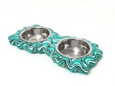 I just love these pet bowls... and they even make it in the color scheme you want! I'm going to get a blue one to match the kitchen.
