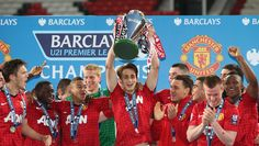 @manutd forward Adnan Januzaj raises aloft the Barclays Under-21 Premier League trophy after he helped the Reds to a 3-2 win over Tottenham Hotspur at Old Trafford in 2013.