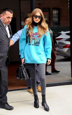 We've spotted Gigi in a variety of really cool graphic sweatshirts and hoodies. Pair one with skinnies and booties for an of-the-moment off-duty look.