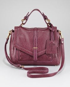 COLOR: Tory Burch Medium Flap Satchel in plum.  Available at CUSP.