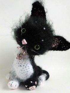 Twinkle, the black and white (and sparkly) mohair kitten