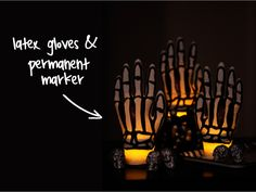 Skeleton Hands Made from Latex Gloves.  Create the spooky skeleton lights by drawing a bones with a sharpie on latex gloves.  Then drop a flameless LED tea light into a small mason jar and snap the opening of the skeleton glove around the jar's lid.  Perfect for #Halloween.