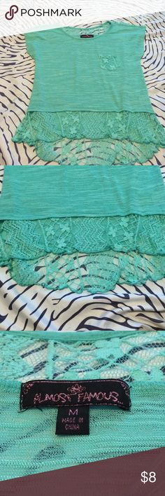 Adorable Top Semi high low top. Sea Foam green color. Lace detail. Worn once. Almost Famous Tops