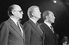 Israel...Menachem Begin, Jimmy Carter & Anwar Sadat celebrating the signing of the Camp David Accords