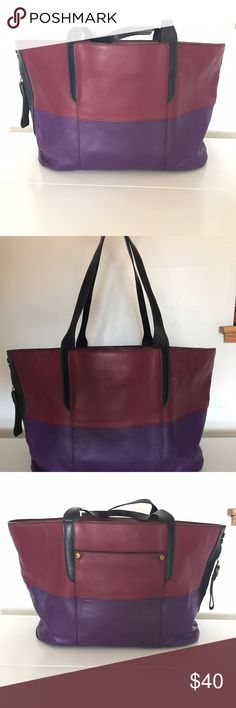Huge Pop of Color Tatiana Colorblock Tote Beautifully structured huge purple tote. Oryany soft pebbled leather tote bag. Golden hardware. Flat tote handles. Open top; snap closure. Inside, center zip separates two compartments; two open and three zip pockets. Signature quatrefoil fabric lining. Outside, front slip pocket and side zip detail. About Oryany: New York-based Oryany offers stylish and functional leather handbags featuring luxurious and practical designs. orYany Bags Totes