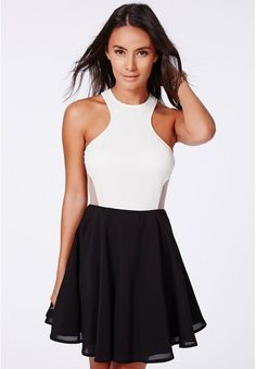This is so simple yet so stylish. Black skirts and white sleeve less top with neck