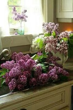 Lilacs. I love the flowers of spring and early summer. Nothing like the fragrance of lilac, honeysuckle, or lily of the valley drifting on a breeze.