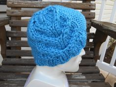 Knit this beautiful cable hat with Lion Brand Hometown USA! Pattern calls for 1 ball of yarn and size 13 knitting needles - instructions also available for other yarn weights!