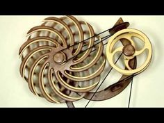 """David C. Roy's Fiesta Kinetic sculpture from """"wood that works"""". Kinetic and wind powered sculptures make me imagine that I can """"see the wind"""""""