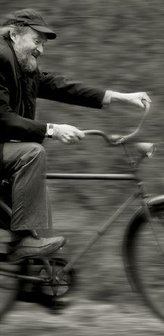 Arvo Pärtriding a bicycle.