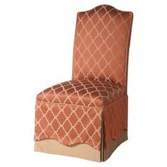 """Skirted Parsons side chair with brick orange trellis-print upholstery.  Product: ChairConstruction Material: Wood and polyesterColor: Brick orangeDimensions: 42.5"""" H x 21.5"""" W x 26"""" D"""