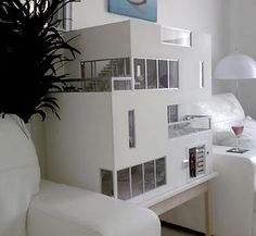 The Clearview Doll house. Really incredible. Gotta see all the pics at http://ifitshipitshere.blogspot.com/2010/01/another-mini-modern-masterpiece.html