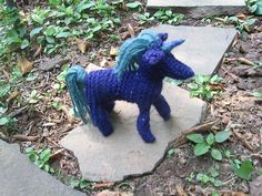 The horse from Anne-Dorthe Grigaff's Knitted Animals book. I felted a horn with some of the scrap yarn and sewed it on to turn the horse into a unicorn!