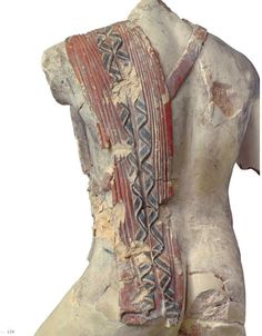 The back view of a nude warrior, His himation preserved its colour, and its amazing plasticity. From a Corinthian workshop, ca 490 BC.