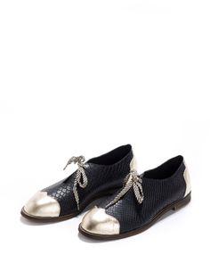 Vente Chaussures plates de Oxford noir. Noir et or