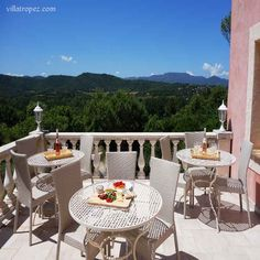 Aperitif suggestions on a balcony overlooking the french countryside of Provence, and the rolling hills of St Tropez. What a nice way to dine, with a light meal in a holiday villa.  www.villatropez.com Natural Stone Flooring, French Countryside, Open Plan Living, Oak Tree, Provence, Living Area, Natural Stones, Balcony, Villa