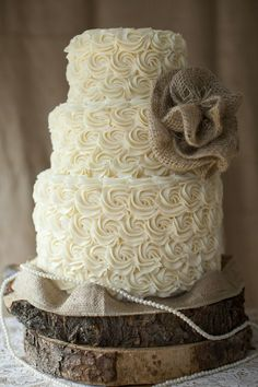 We love this wedding cake from stylemepretty.com.  Dress up a simple cake with burlap and pearls for a shabby chic wedding