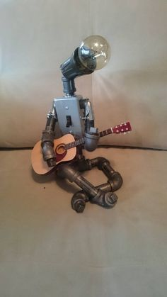 The Guitarist Industrial Pipe Robot Lamp