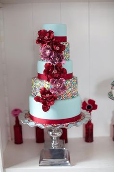 Whimsical Wedding Cake with Rainbow Sprinkles Red Blooms Whimsical Wedding Cakes, Wedding Cake Red, Beautiful Wedding Cakes, Gorgeous Cakes, Pretty Cakes, Amazing Cakes, Floral Wedding, Sprinkle Wedding Cakes, Sprinkle Cakes